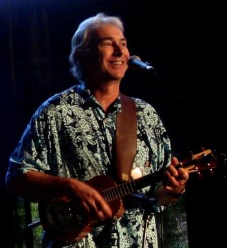 photo of Mark Kailana Nelson playing the ukulele at the Northwest Folkife Festival
