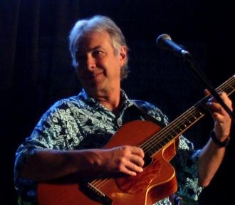 photo of Mark Kailana Nelson playing guitar at the Northwest Folklife Festival