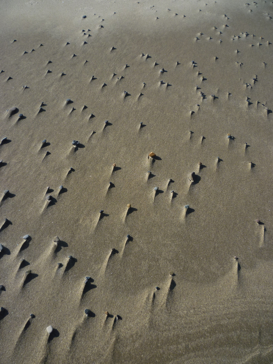 Photo of Beach Pebbles and Wind Tracks